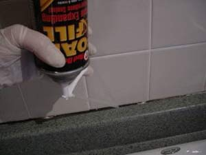 filling a crack with expanding foam