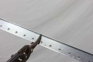 cutting metal drywall corner bead with tin snips
