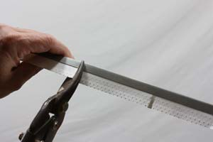 cutting drywall corner bead with tin snips