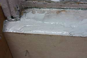 epoxy filler in a form around a rotted windowsill