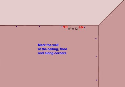 marking a wall for plaster key repair