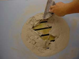 filling a deep plaster hole with setting-type joint compound