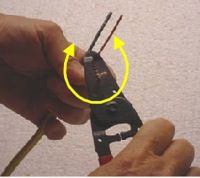 using wire strippers to remove electrical wire insulation