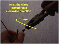twisting clockwise to splice wires together
